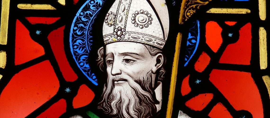 a stained glass image of st. patrick patron saint of ireland.